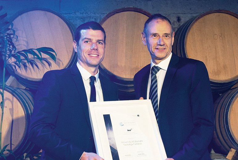 BNZ's Graeme Geurtz presents the supreme  award to University of Waikato's Alister Jones