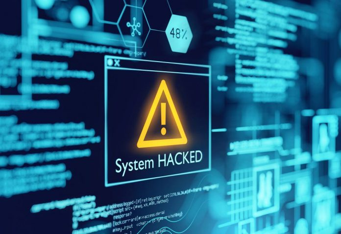 IT system mainframe showing a message of System Hacked